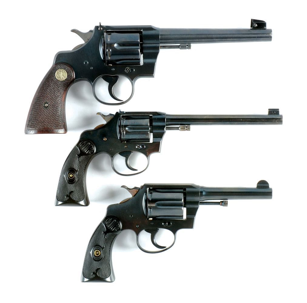 (C) LOT OF THREE: THREE COLT DOUBLE ACTION REVOLVERS.
