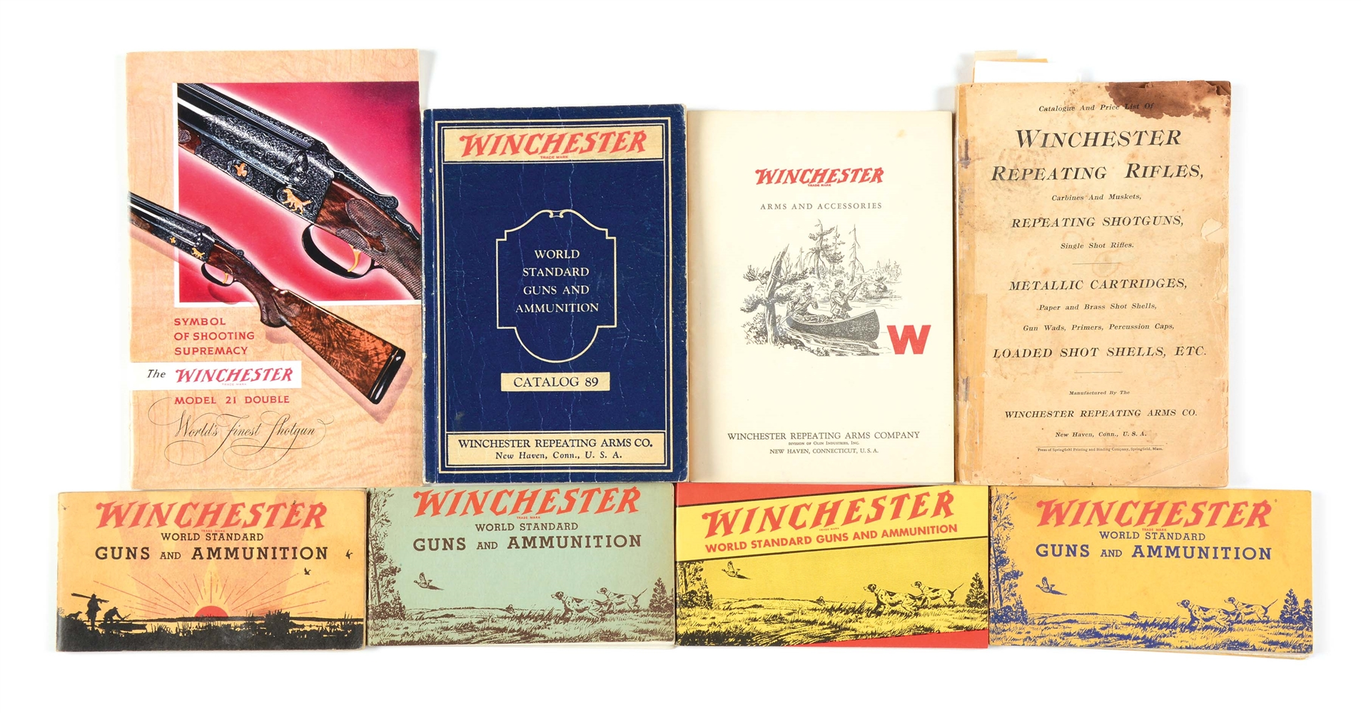 COLLECTORS LOT OF EIGHT WINCHESTER CATALOGS.