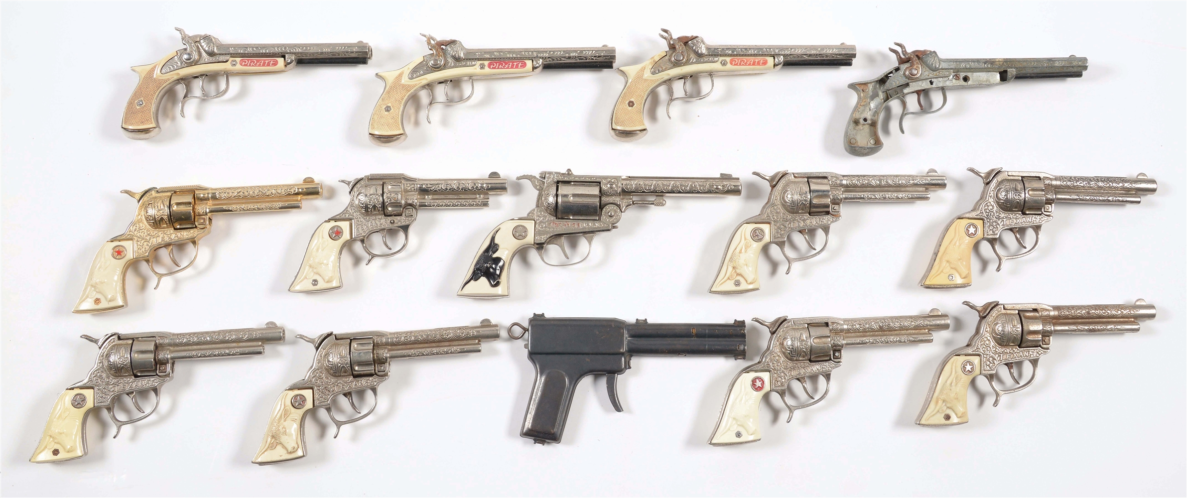 LOT OF 14 VARIOUS CAP AND OTHER CHILDRENS PISTOLS.