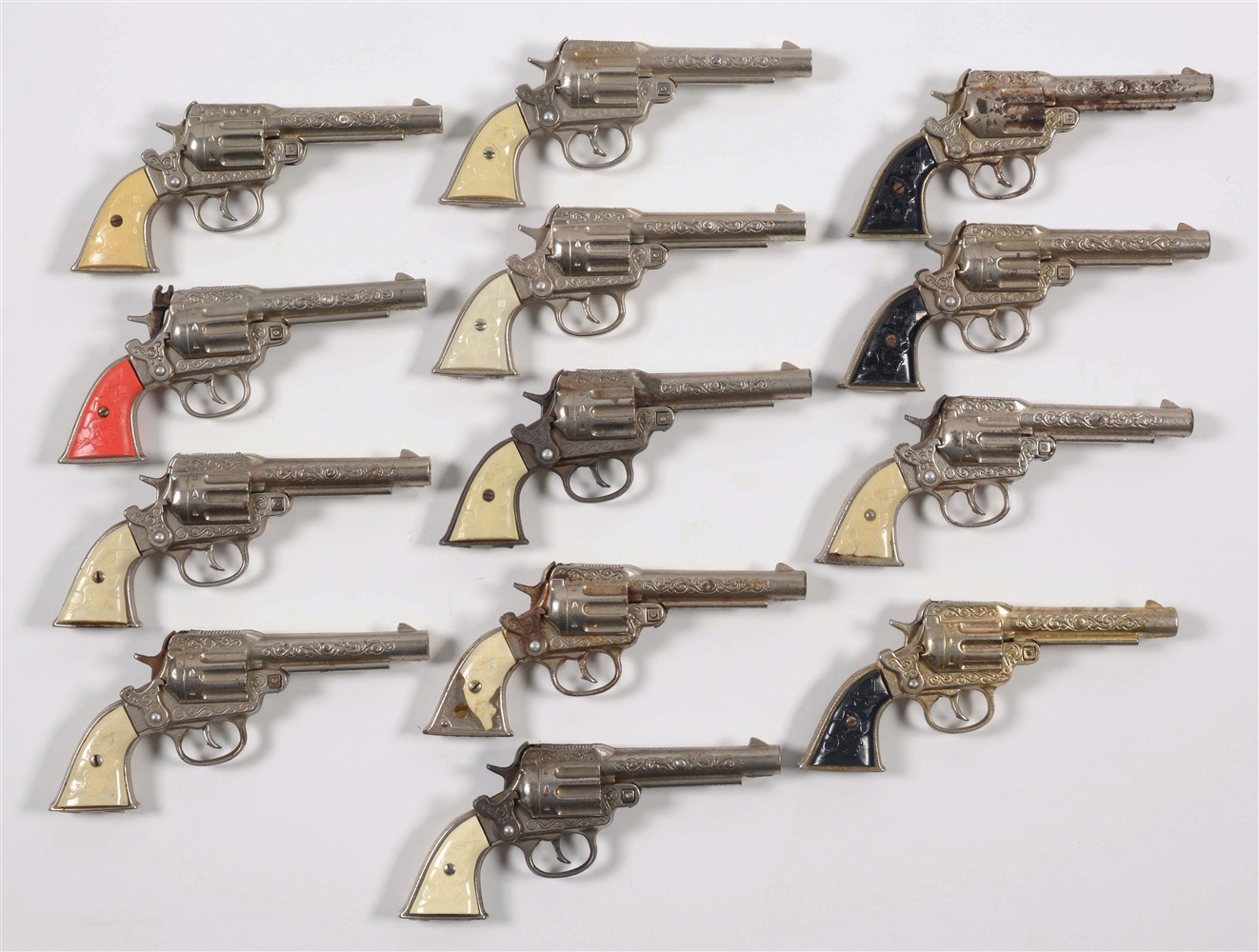 LOT OF 13 VARIOUS DIFFERENT PEACEMAKER CAP PISTOLS.