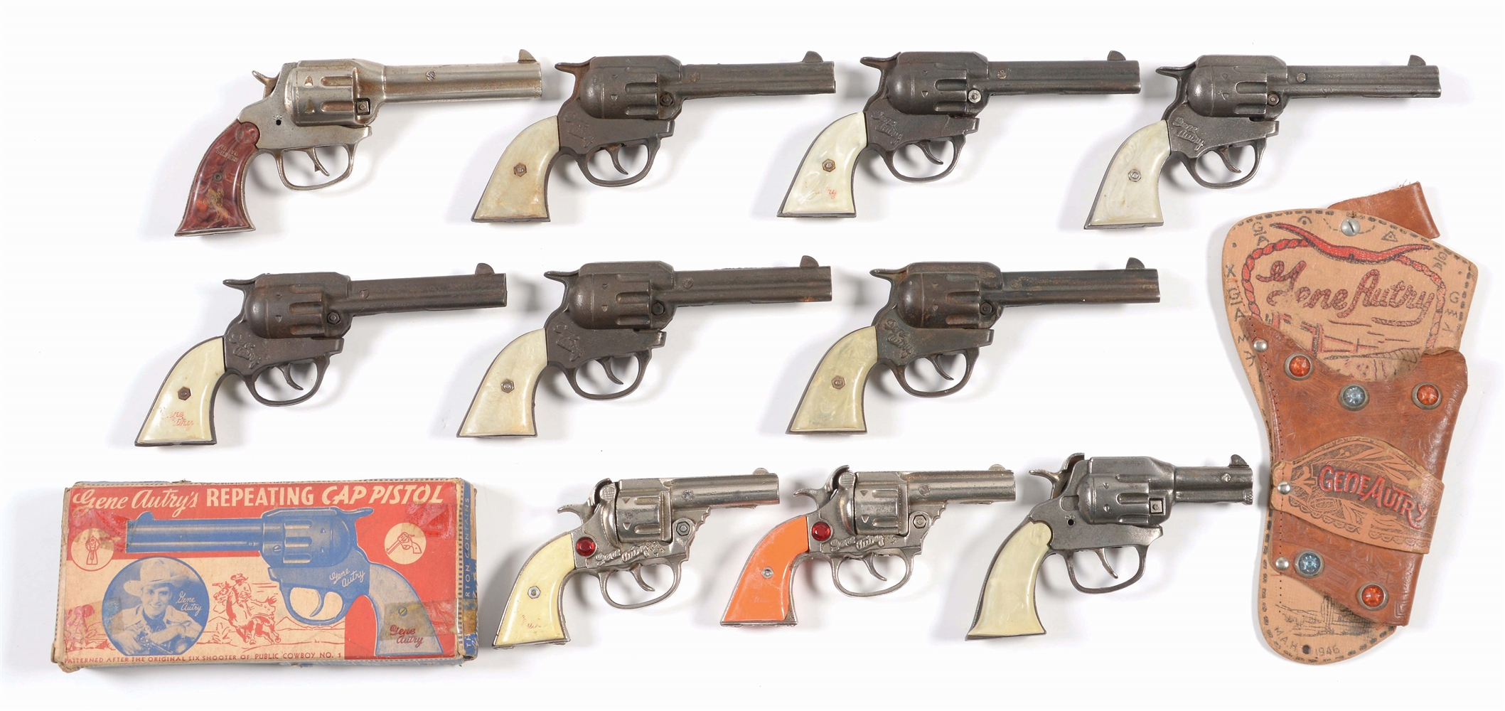 LOT OF 10: VARIOUS GENE AUTRY AND LONE RANGER CAP PISTOLS.