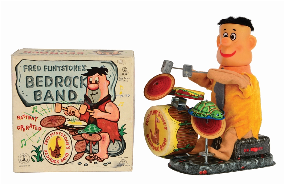 ALPS BATTERY-OPERATED FRED FLINTSTONE BEDROCK BAND TOY.