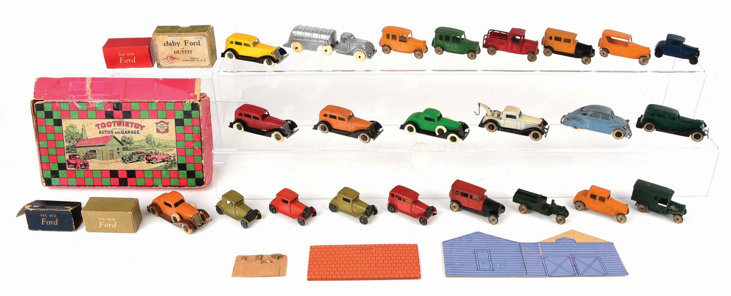 NICE LOT OF APPROXIMATELY 20 EARLY TOOTSIE TOYS AND OTHER SLUSH MOLD VEHICLES.
