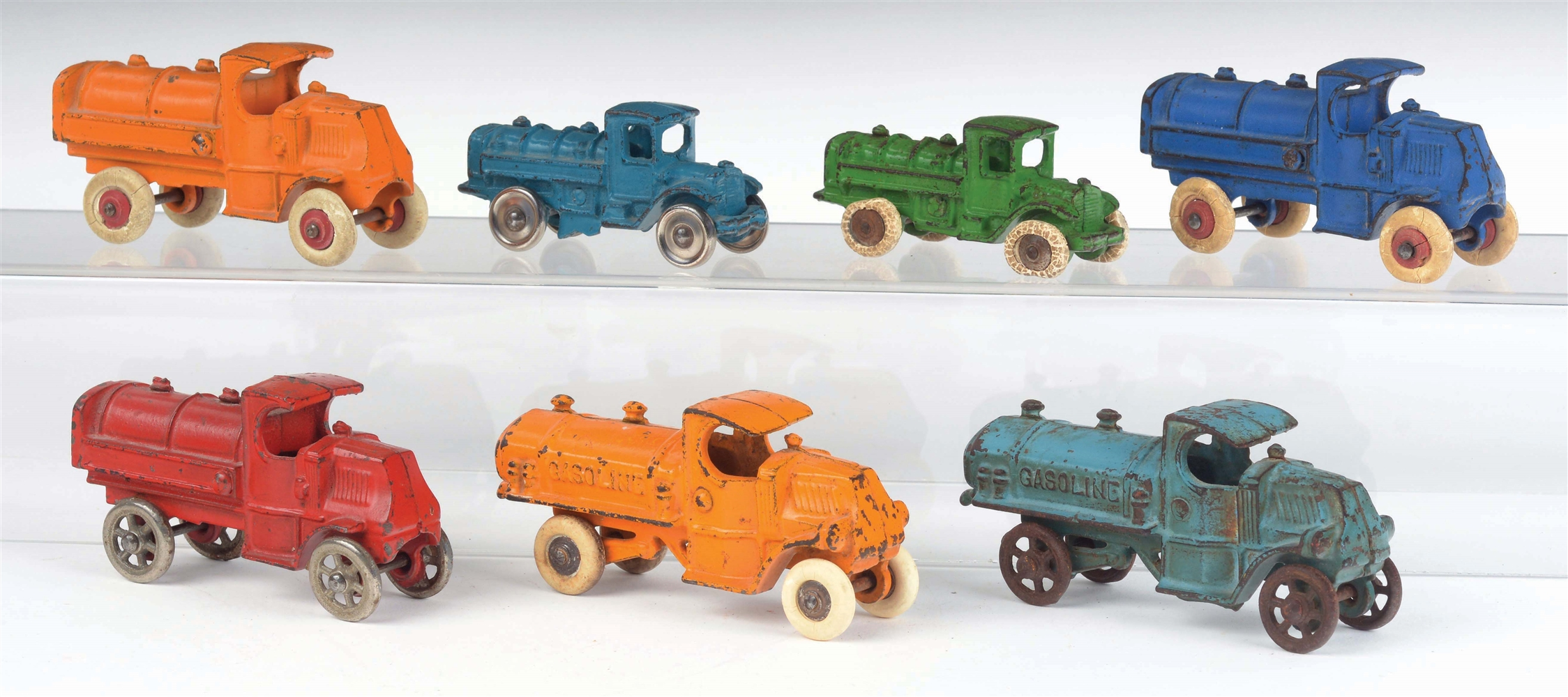 LOT OF 7: AMERICAN MADE CAST-IRON GASOLINE TRUCKS.