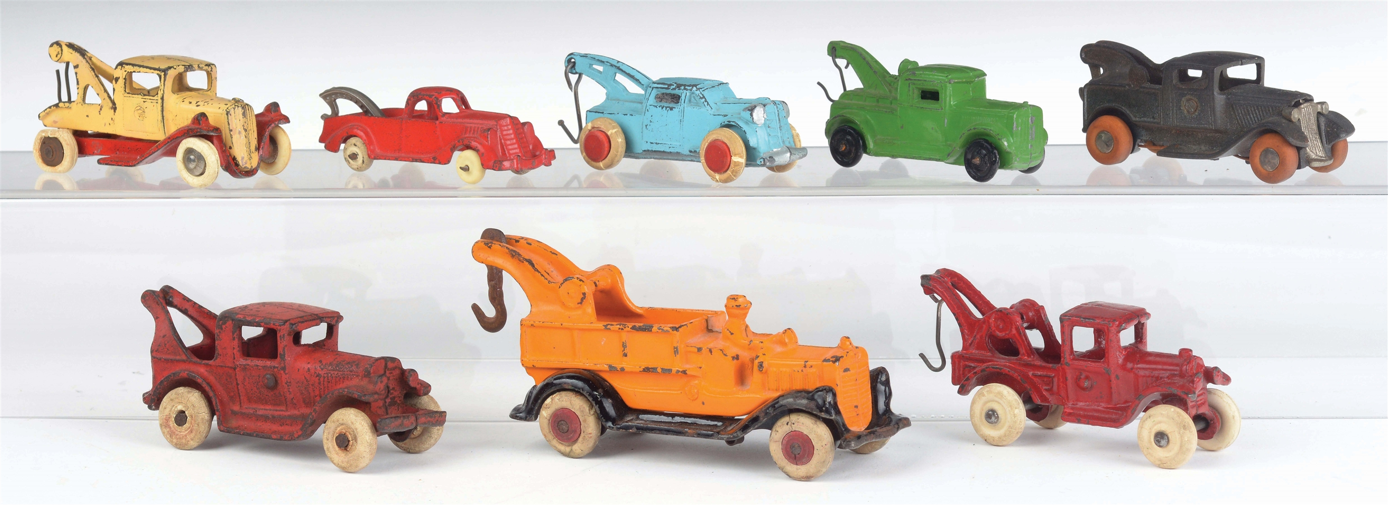 LOT OF 8: VARIOUS CAST-IRON AND SLUSH MOLD TOW TRUCKS.