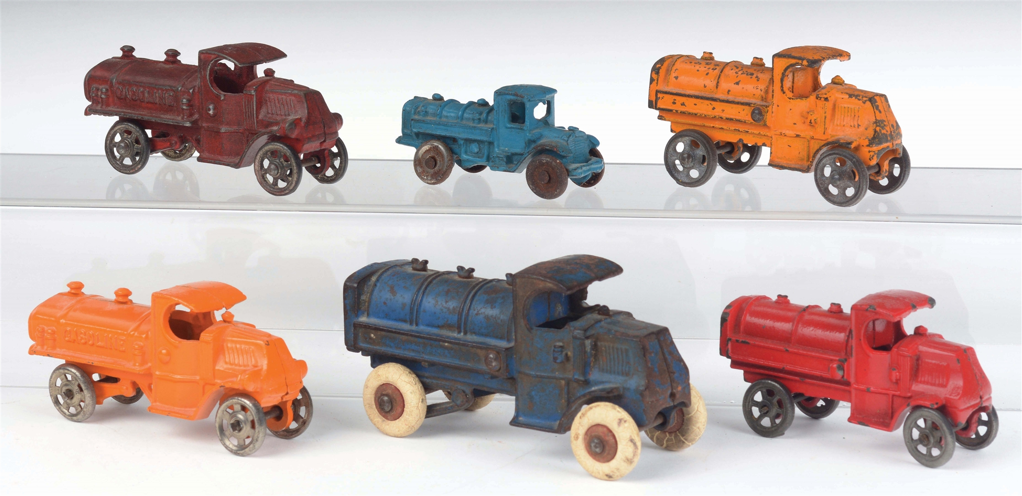 LOT OF 6: AMERICAN MADE CAST-IRON GASOLINE TRUCKS.