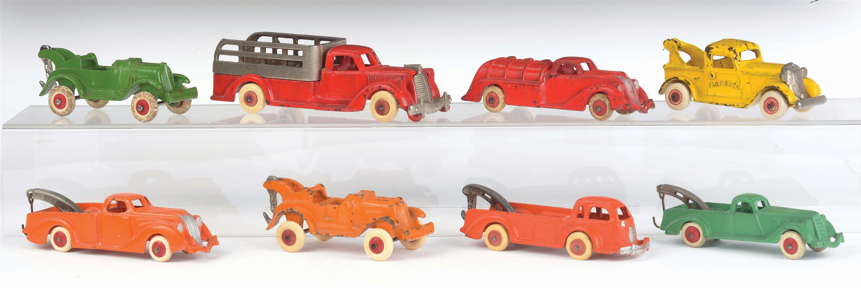 LOT OF 8: CAST-IRON HUBLEY VEHICLES.