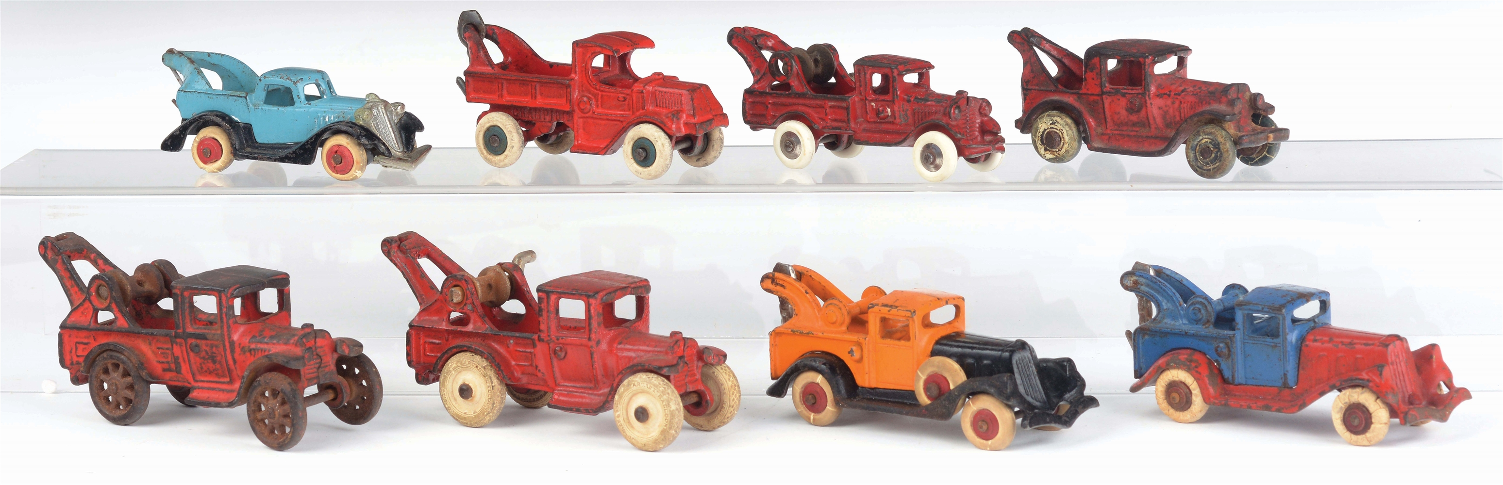 LOT OF 8: CAST-IRON AMERICAN MADE TOW TRUCKS.