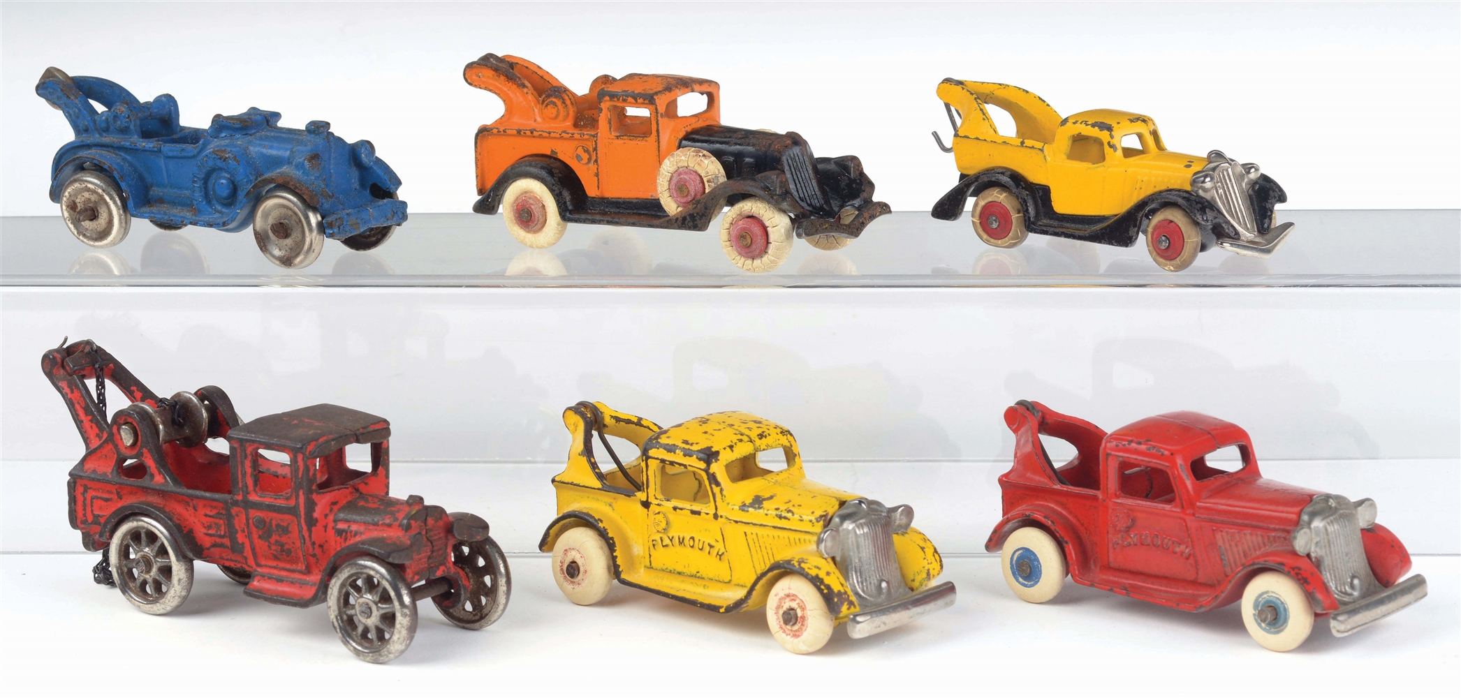 LOT OF 6: CAST-IRON AMERICAN MADE TOW TRUCKS.