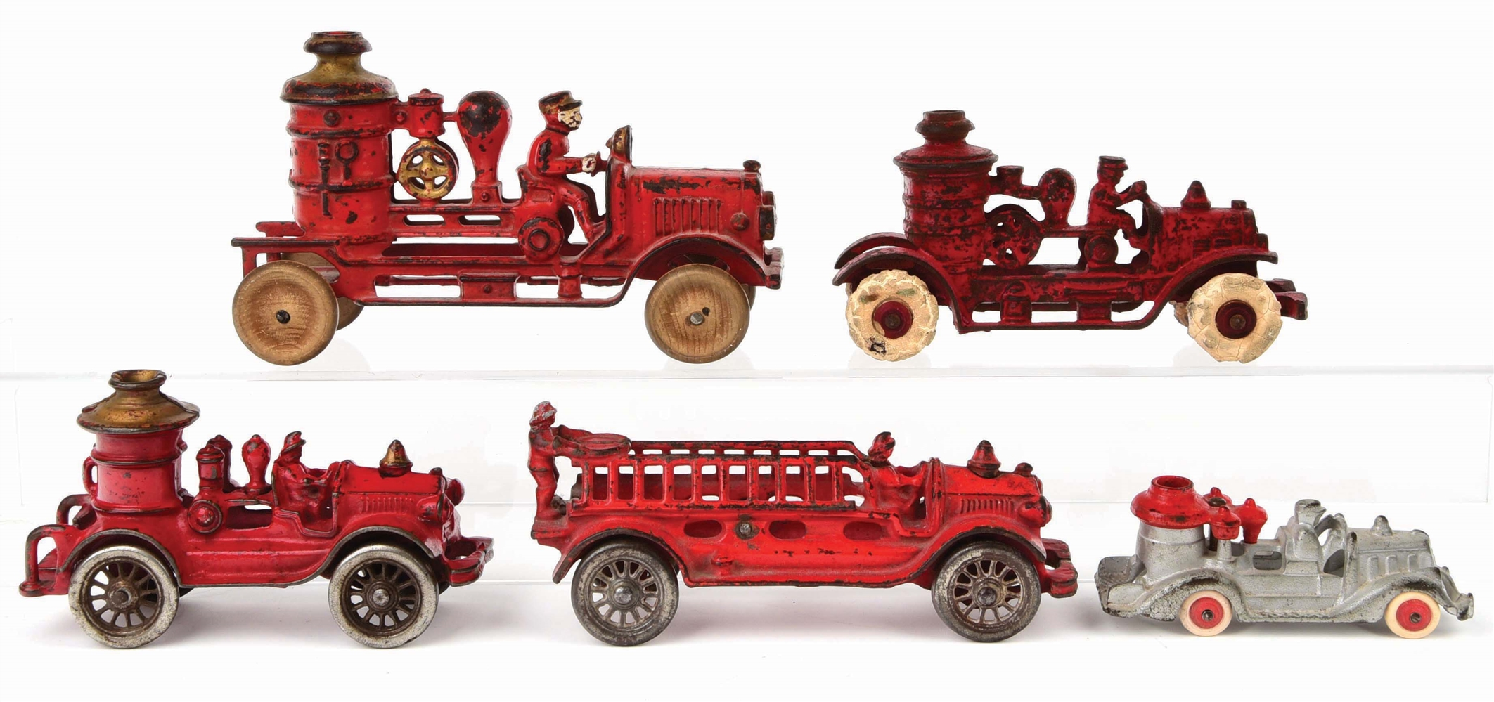 LOT OF 5: CAST-IRON AMERICAN MADE FIRE PUMPER AND LADDER TRUCKS.