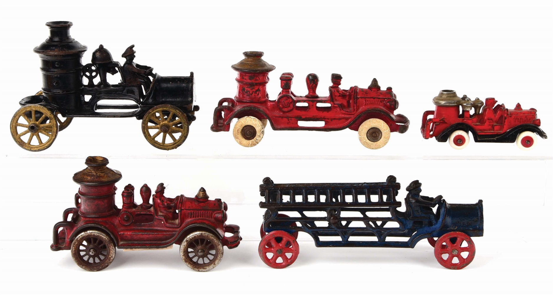 LOT OF 5: AMERICAN MADE CAST-IRON FIRE PUMPER AND LADDER TRUCKS.