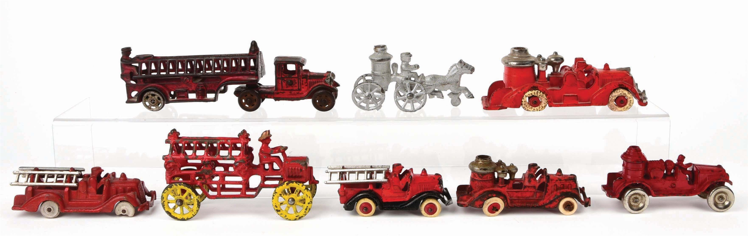 LOT OF 8: AMERICAN MADE CAST-IRON FIRE LADDER AND PUMPER TRUCKS.