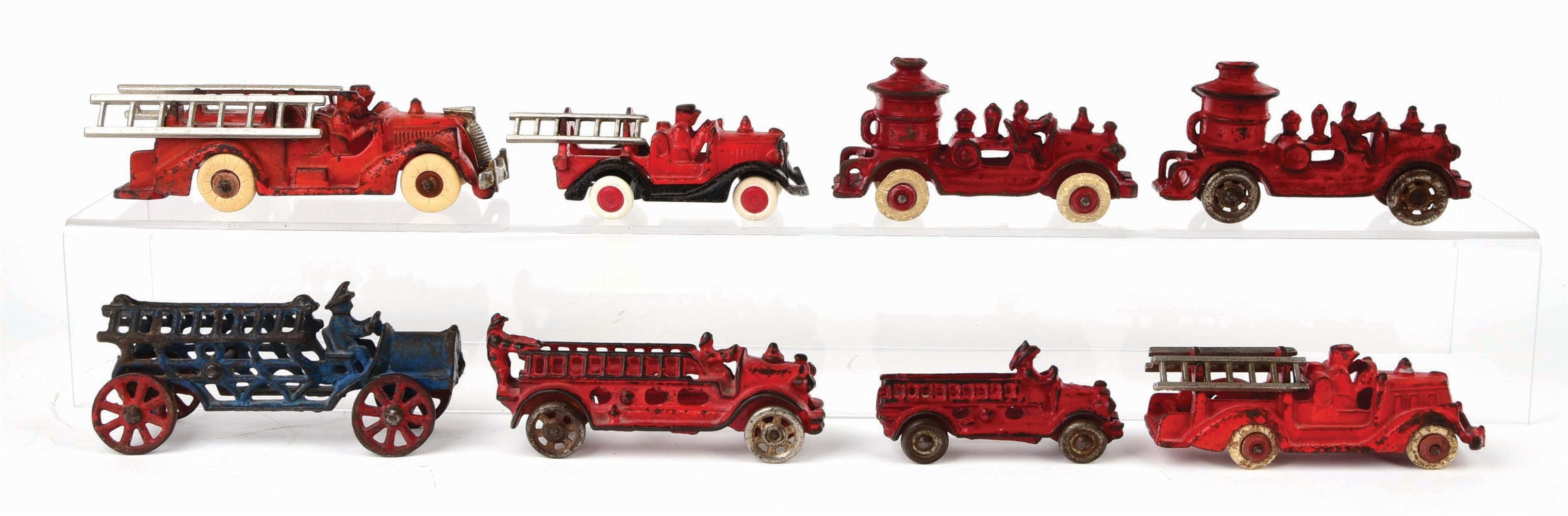 LOT OF 8: CAST-IRON AMERICAN MADE FIRE LADDER AND PUMPER TRUCKS.