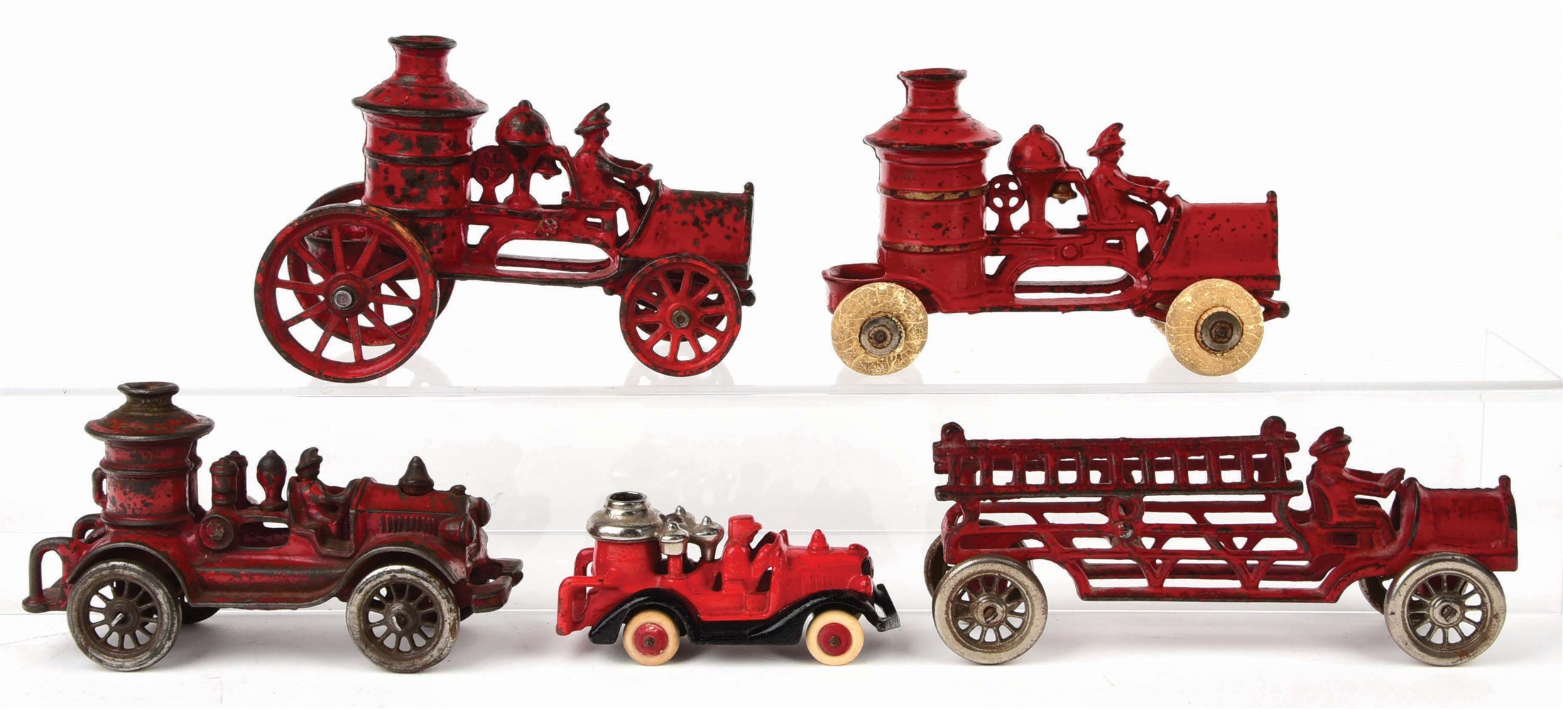 LOT OF 5: AMERICAN MADE CAST-IRON FIRE PUMPER AND LADDER VEHICLES.