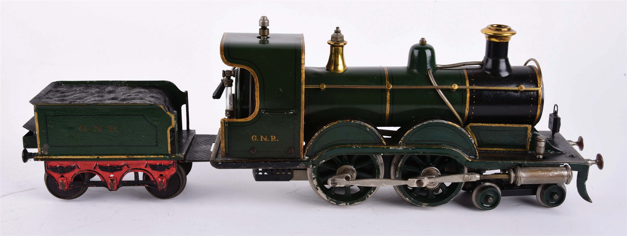 PRE-WAR GERMAN HAND-PAINTED BING STEAM ENGINE AND MATCHING TENDER.