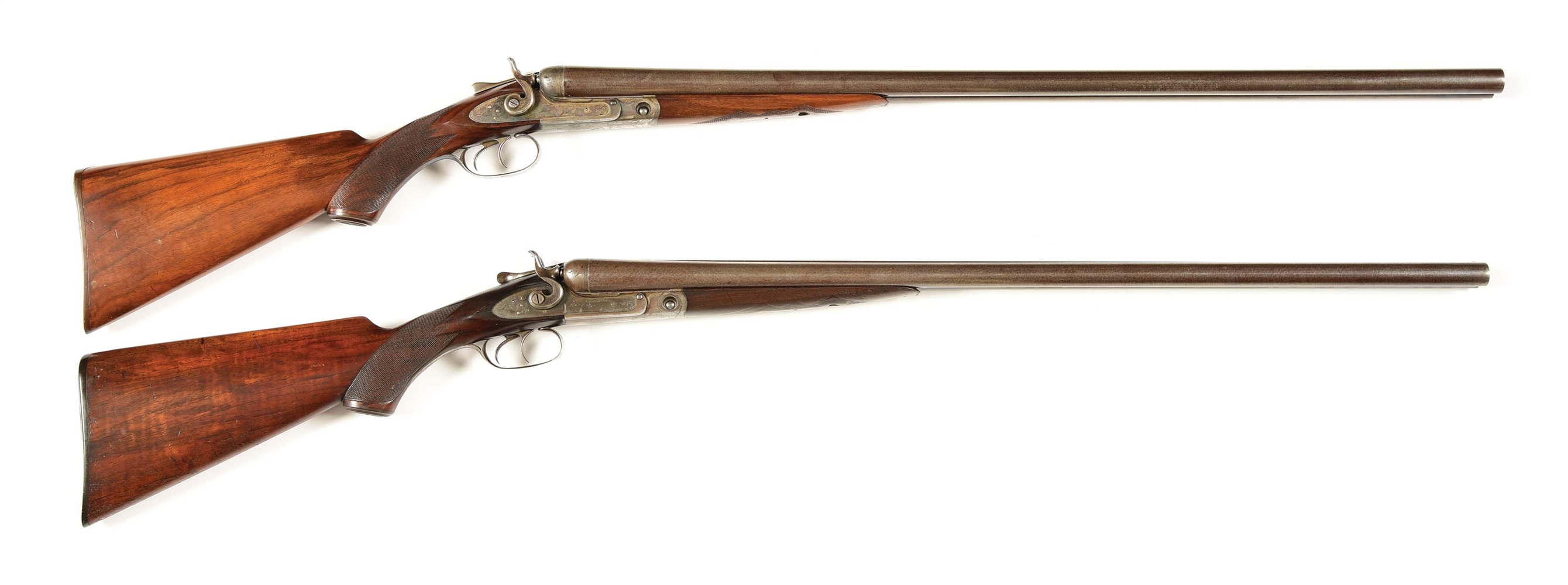 (A) LOT OF TWO: TWO PARKER GRADE 2 12 GAUGE PERCUSSION SHOTGUNS.