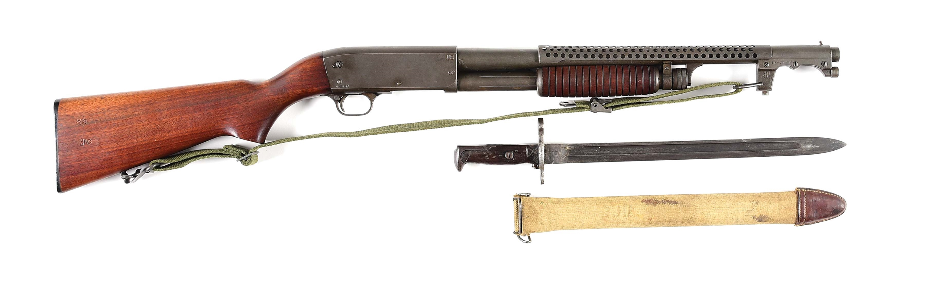 (C) ITHACA 37 TRENCH STYLE SLIDE ACTION SHOTGUN WITH BAYONET.
