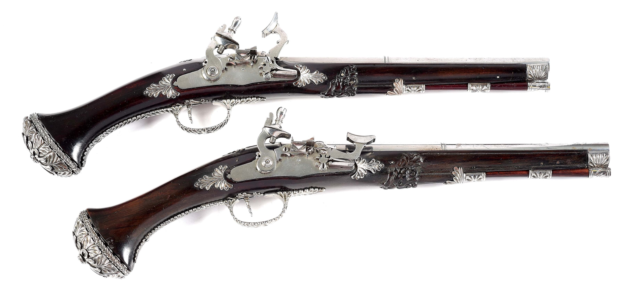 (A) SNAPHAUNCE PISTOLS WITH ORNATE MOUNTINGS IN THE STYLE OF 17TH CENTURY SWISS, EX. W.G. RENWICK.