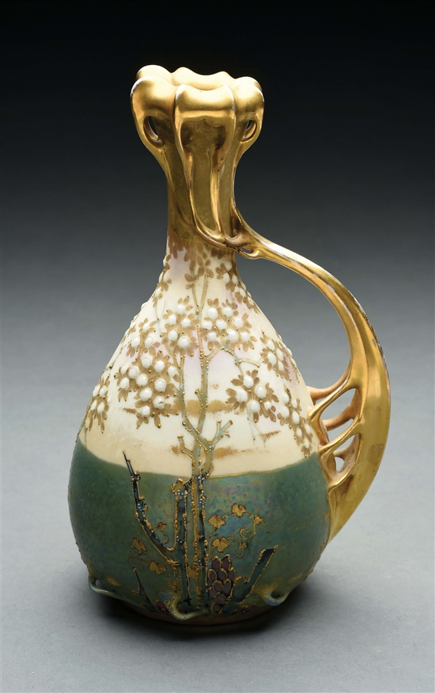 AMPHORA VASE WITH INTRICATE FLORAL DESIGN.