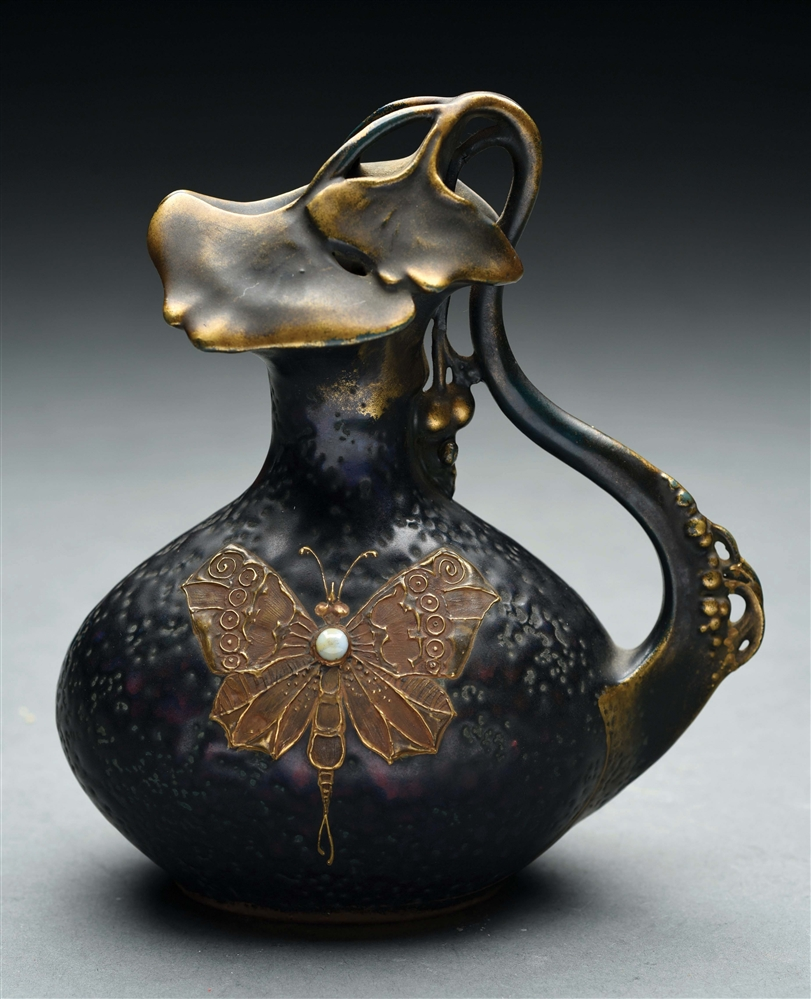 AMPHORA GINKO PITCHER WITH APPIED JEWELED BUTTERFLY.