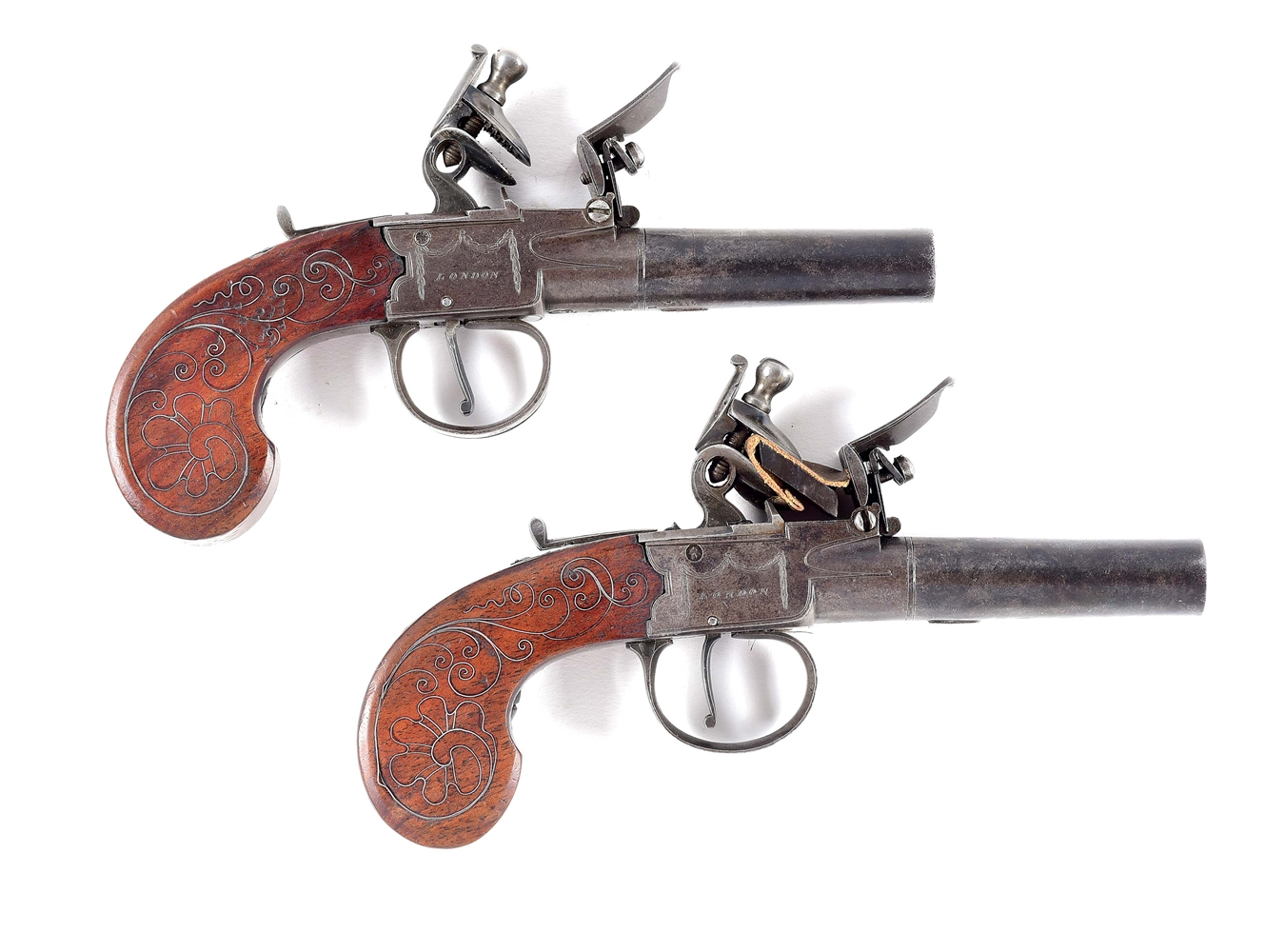 (A) A GOOD PAIR OF BASS AND CO MUFF PISTOLS WITH SILVER INLAID GRIPS.