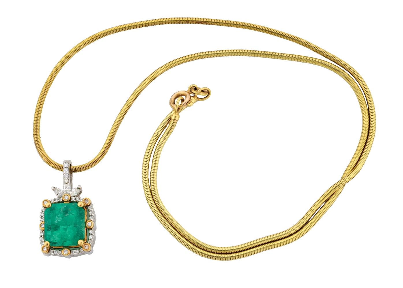 LADYS PLATINUM & 18K GOLD EMERALD & DIAMOND PENDANT WITH 14K SNAKE CHAIN AND APPRAISAL.