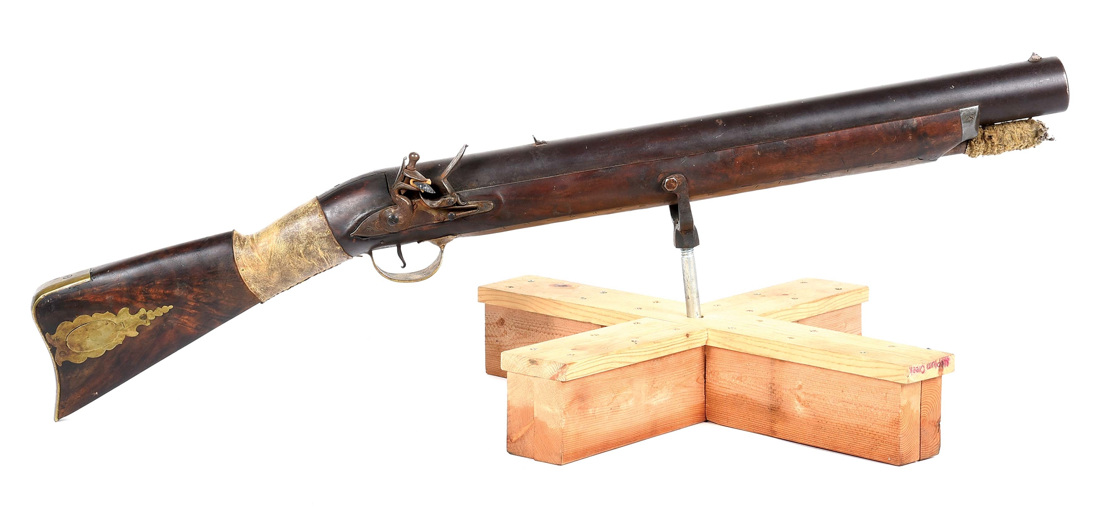 "(A) A MASSIVE FLINTLOCK WALL GUN, USED IN THE 1976 FILM ""THE MISSOURI BREAKS""."