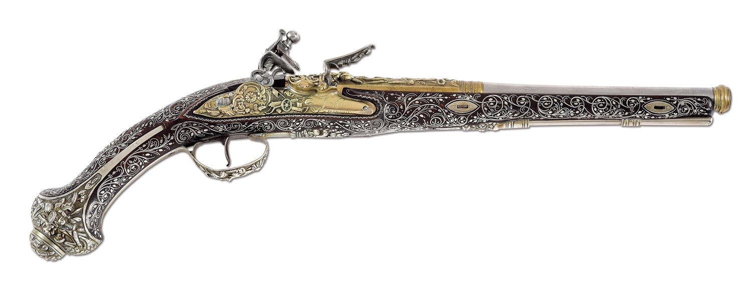 (A) A FRENCH FLINTLOCK PISTOL MARKED LOUIS LAMOTTE, WITH EXTENSIVE BRASS DECORATIONS AND SILVER INLAY ON STOCK, LIKELY MADE FOR THE MIDDLE EASTERN OR TOURIST TRADE.
