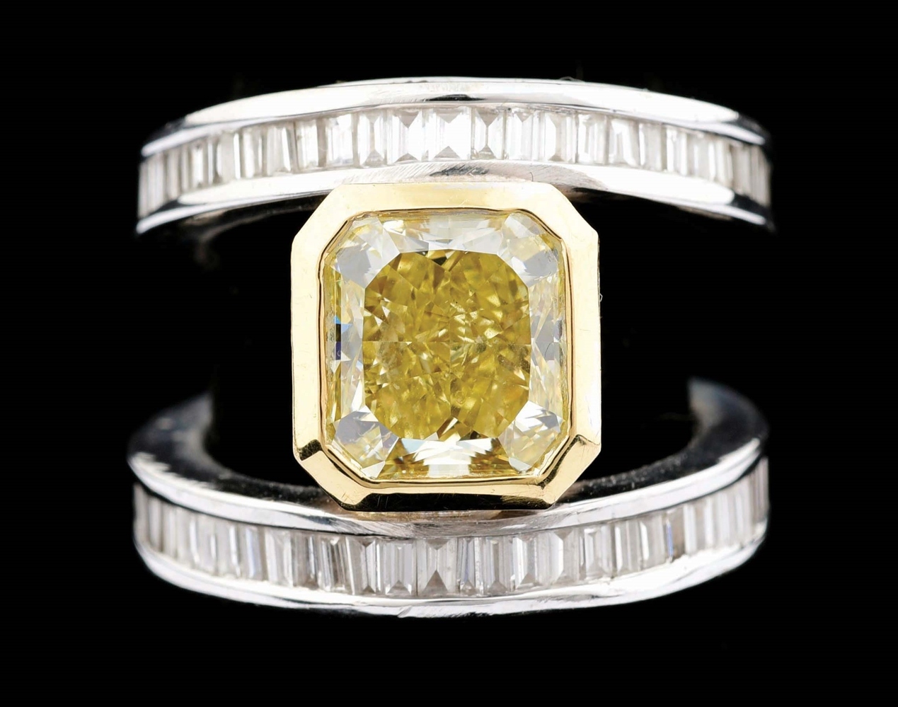 18K WHITE GOLD 4CT FANCY YELLOW DIAMOND RING WITH GIA REPORT AND APPRAISAL.