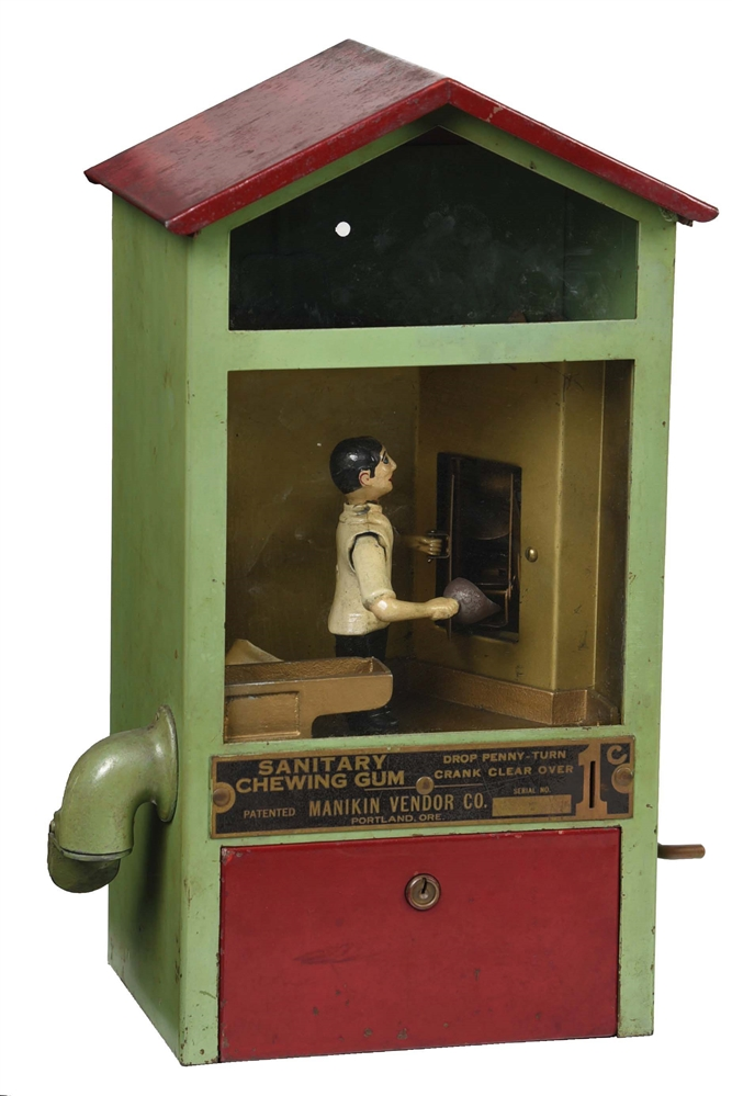 1¢ MANIKIN VENDOR CO. BAKER BOY GUM BALL VENDING MACHINE.